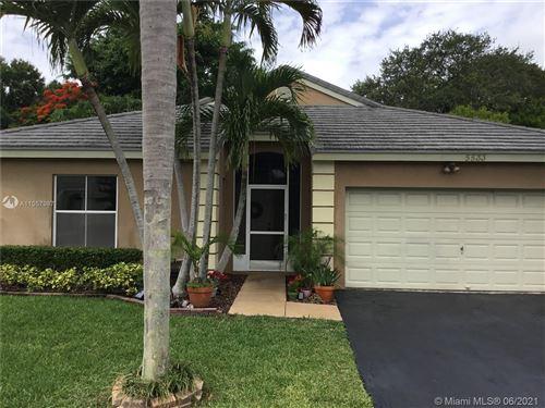 Photo of 5533 NW 55th Terrace, Coconut Creek, FL 33073 (MLS # A11057987)