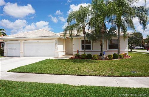 Photo of 5607 NW 109th Way, Coral Springs, FL 33076 (MLS # A10836988)