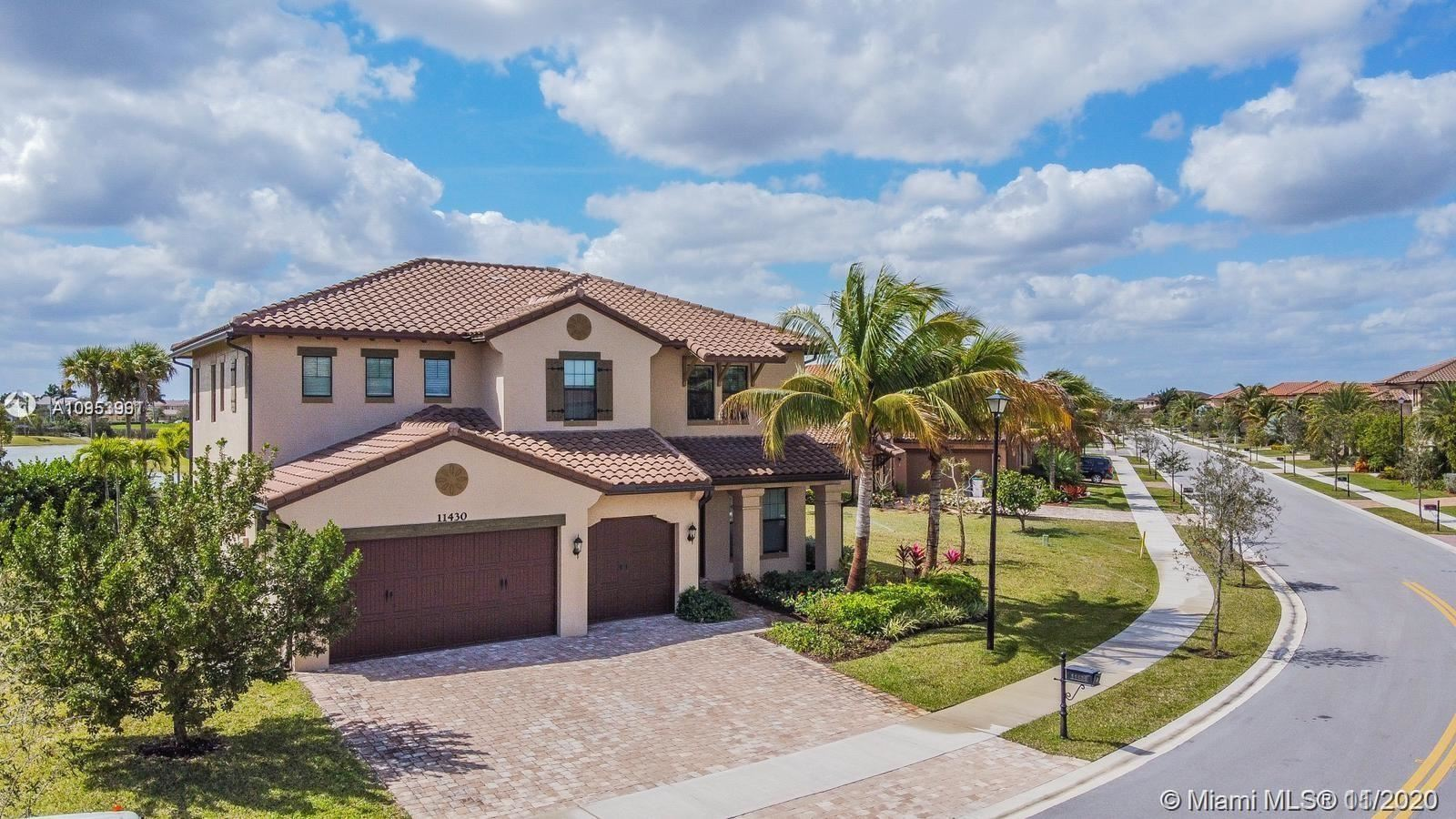 Photo of 11430 NW 83rd Way, Parkland, FL 33076 (MLS # A10953991)