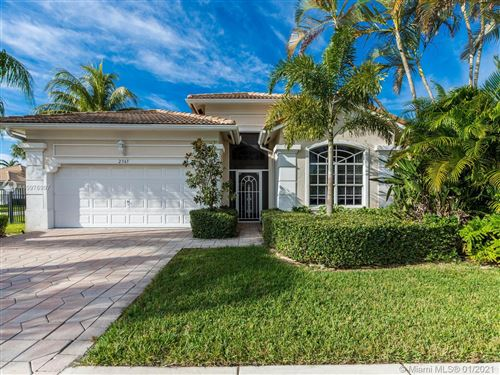 Photo of 2365 PIGEON CAY, West Palm Beach, FL 33411 (MLS # A10976997)