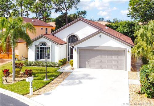 Photo of 160 Paddock Ln, Green Acres, FL 33413 (MLS # A10987997)