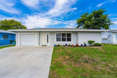 Photo of 6103 NW 74th Ave, Tamarac, FL 33321 (MLS # A11042997)