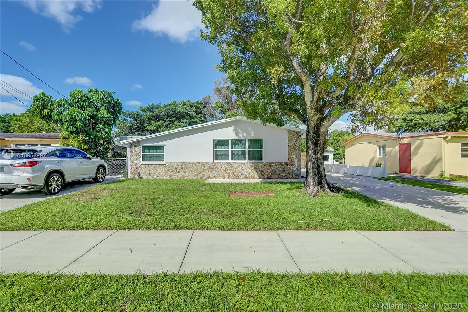 Photo of 5921 NW 41st Ter, North Lauderdale, FL 33319 (MLS # A10952997)