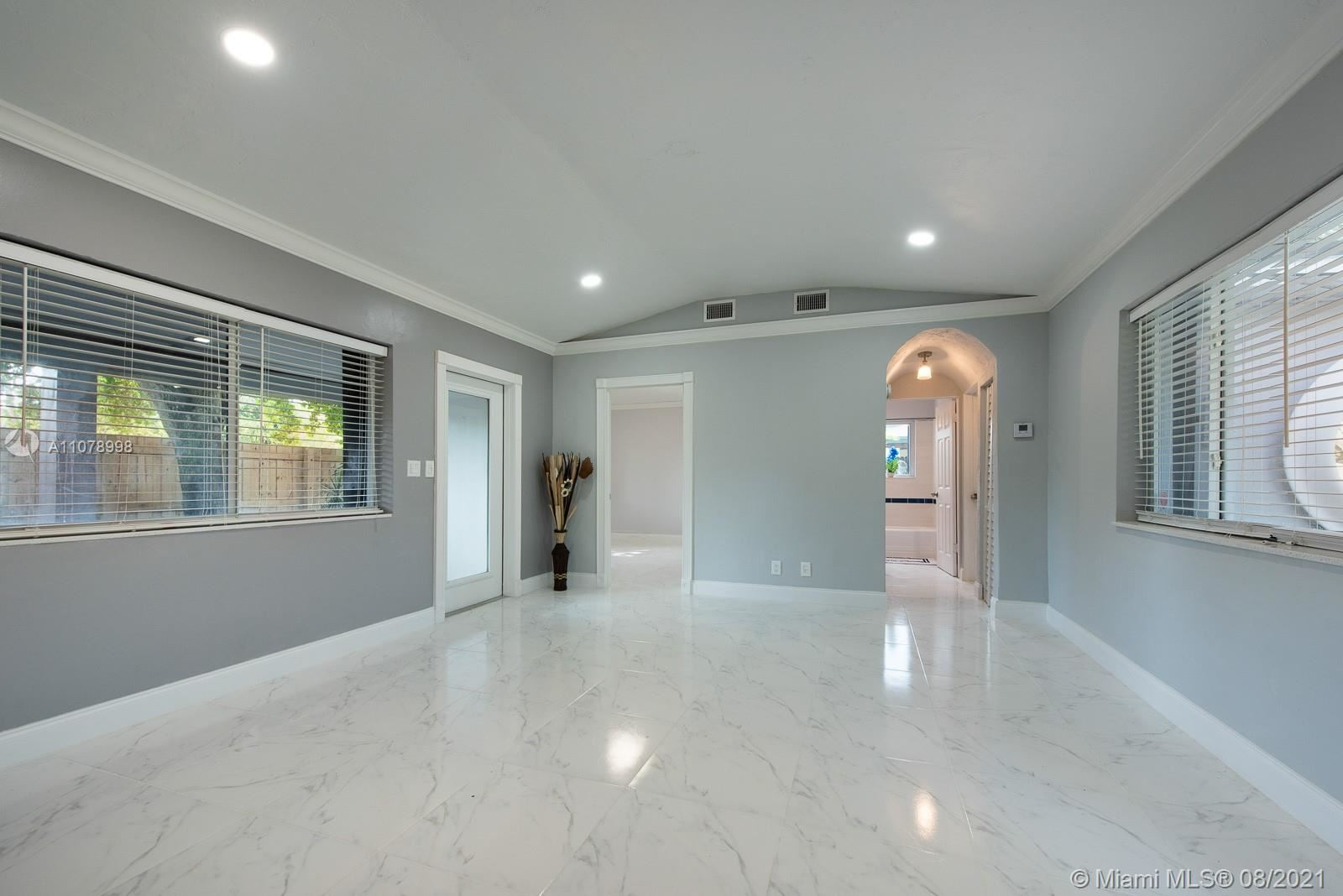Photo of 1453 NE 15th Ave, Fort Lauderdale, FL 33304 (MLS # A11078998)