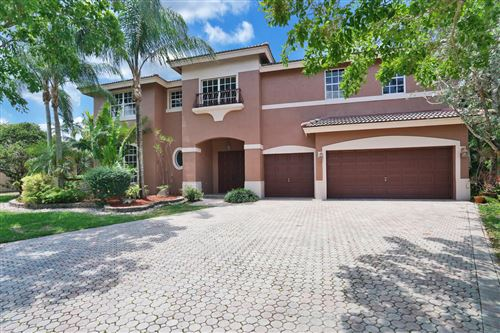 Photo of 402 NW 118th Terrace, Coral Springs, FL 33071 (MLS # RX-10714000)