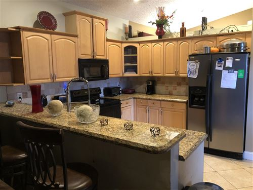 Photo of Listing MLS rx in 6052 NW 73rd Court Parkland FL 33067