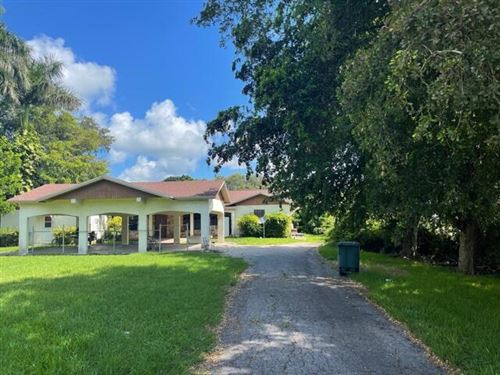 Photo of 1241 NW Avenue D Avenue, Belle Glade, FL 33430 (MLS # RX-10735006)