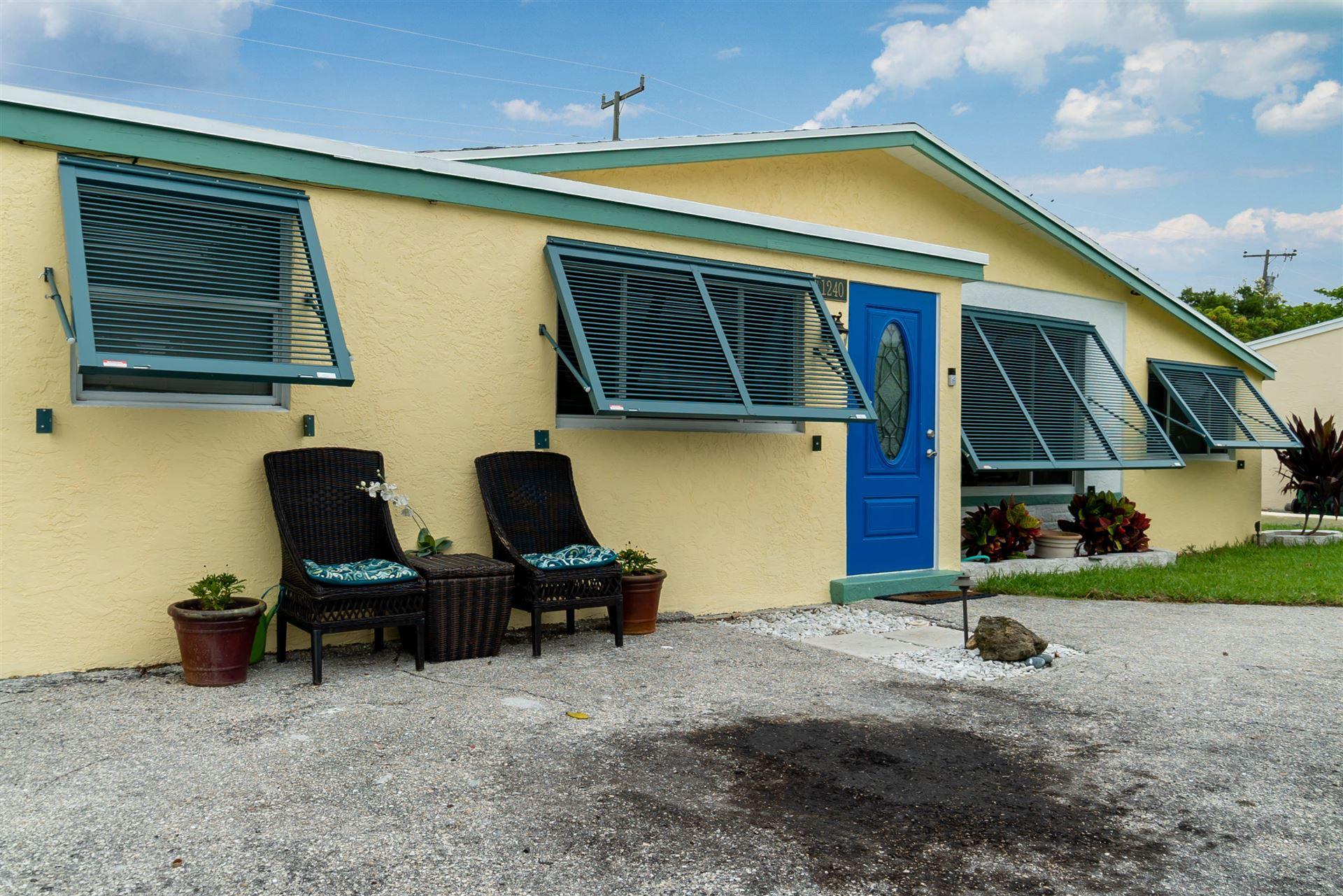 Photo of 1240 W 3rd Street, Riviera Beach, FL 33404 (MLS # RX-10730007)