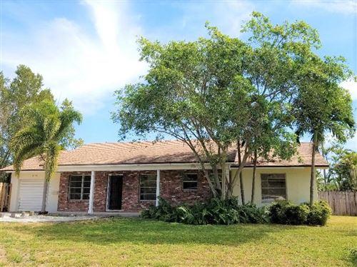 Photo of 6630 Mango Circle, Lake Clarke Shores, FL 33406 (MLS # RX-10612008)