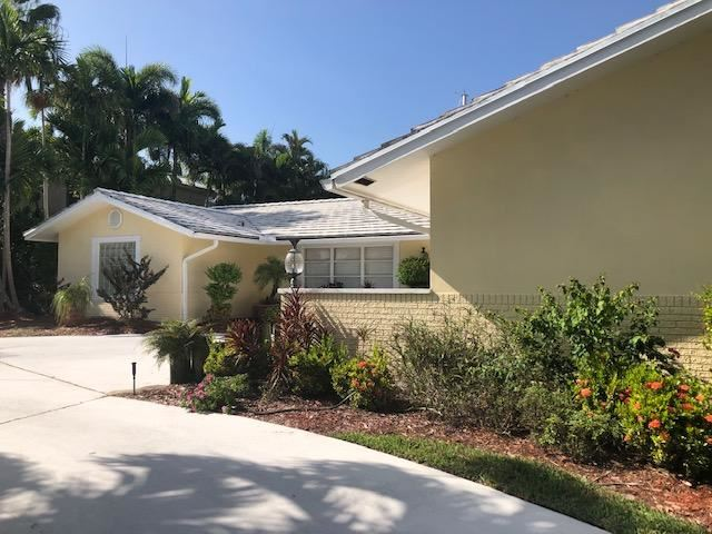 Photo of 1110 Fairview Lane, Riviera Beach, FL 33404 (MLS # RX-10652008)