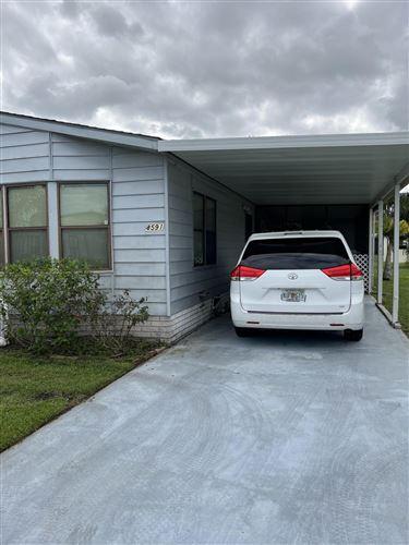 Photo of 8591 Mary Ann Lane, Fort Pierce, FL 34952 (MLS # RX-10752011)