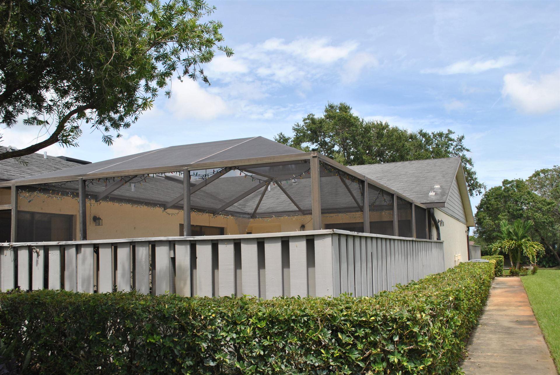 Photo of 1531 Pheasant Walk #D, Fort Pierce, FL 34950 (MLS # RX-10747019)