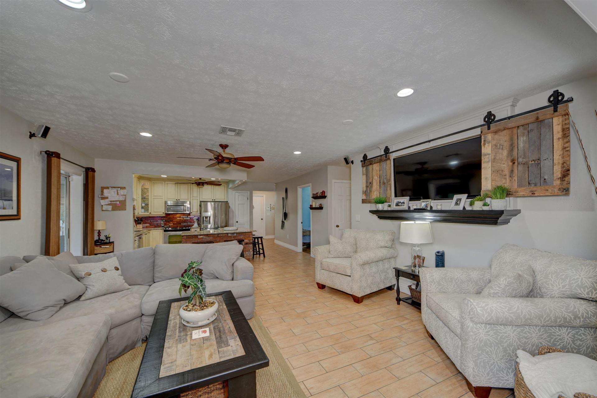Photo of 2401 SE Sherlock Lane, Port Saint Lucie, FL 34952 (MLS # RX-10662021)
