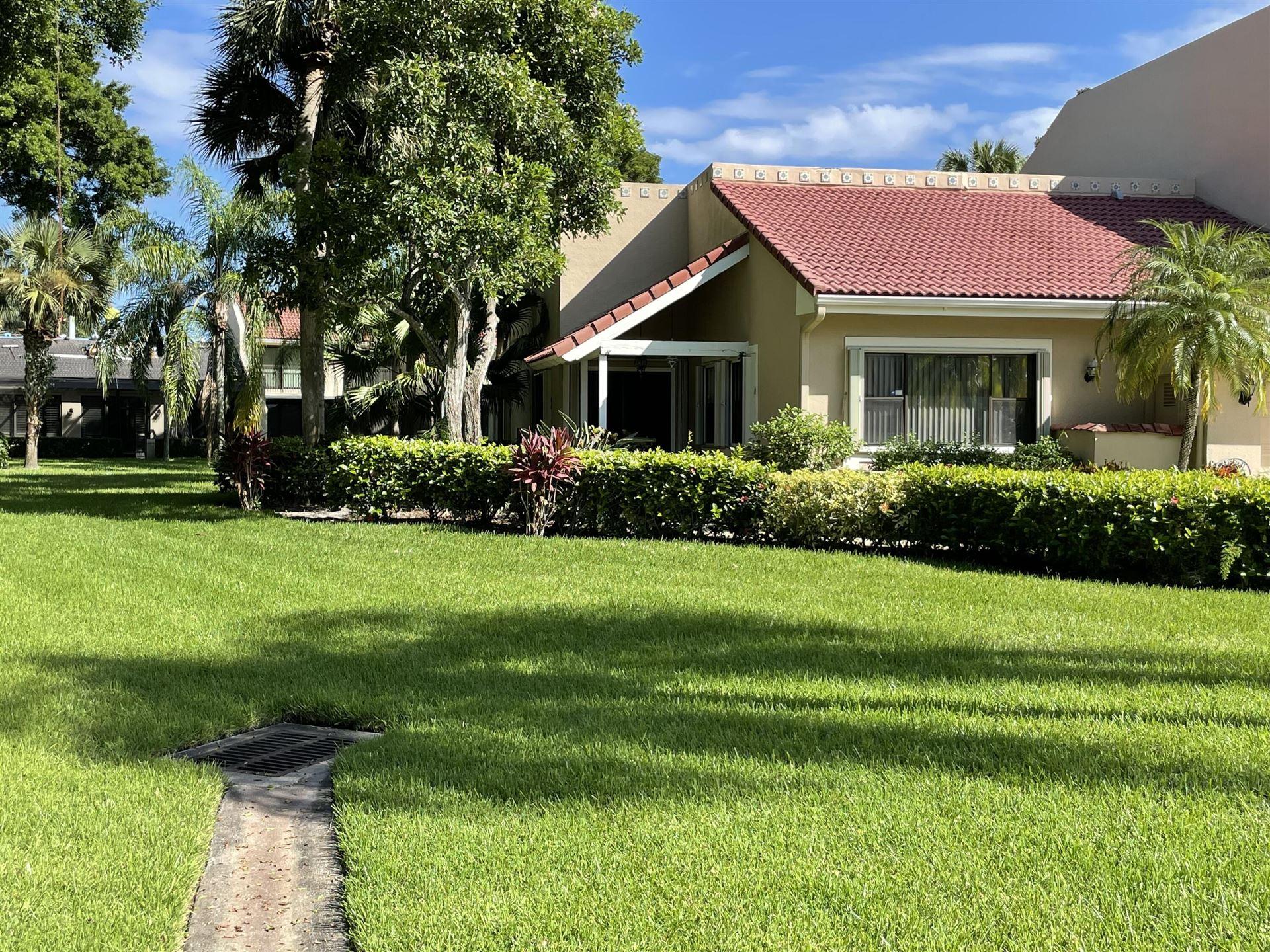 Photo of 702 Windermere Way, Palm Beach Gardens, FL 33418 (MLS # RX-10750022)