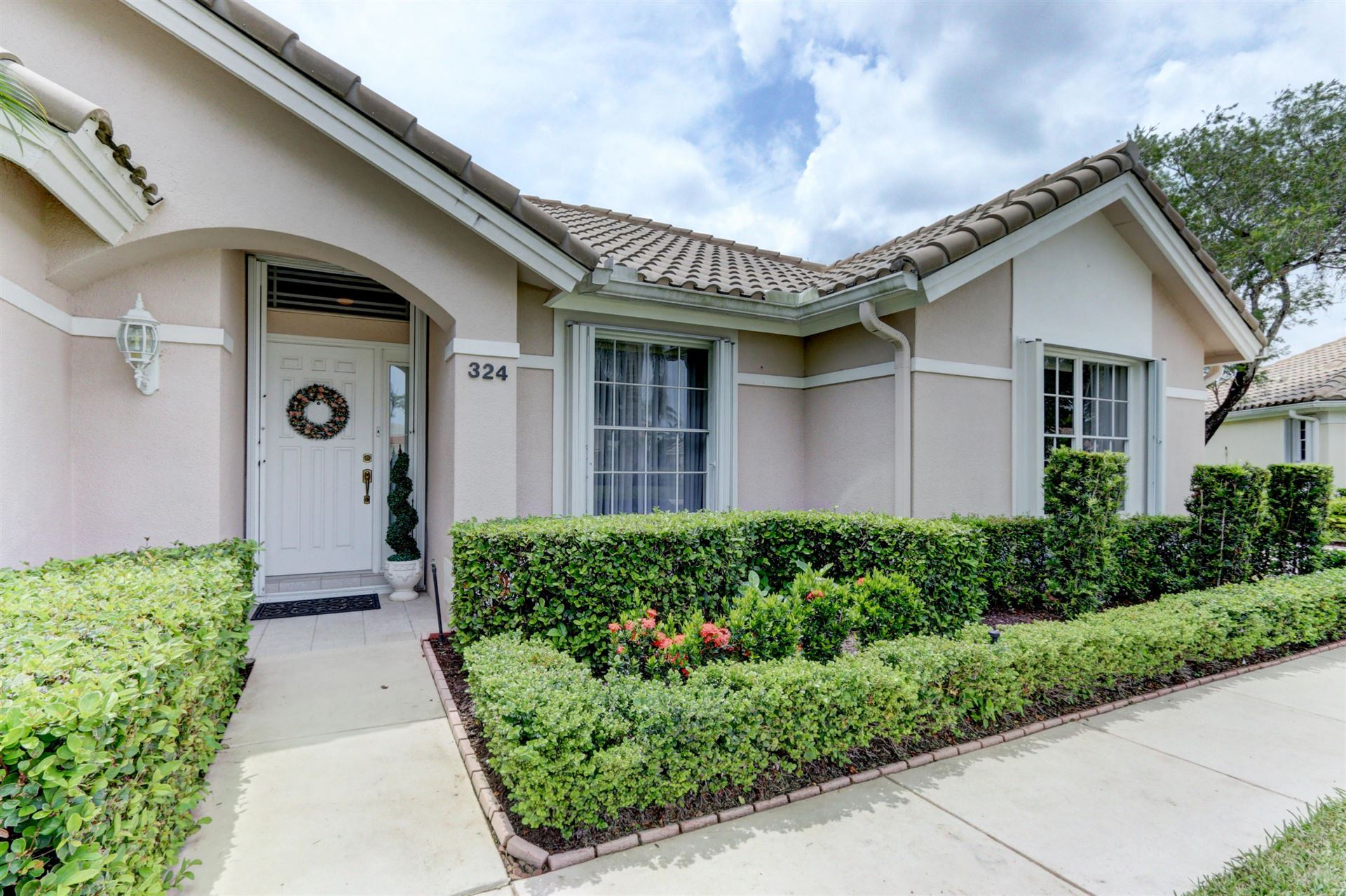 Photo of 324 Eagleton Golf Drive, Palm Beach Gardens, FL 33418 (MLS # RX-10649023)