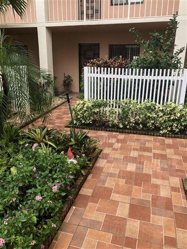 Photo of 7290 Kinghurst Drive #104, Delray Beach, FL 33446 (MLS # RX-10751027)