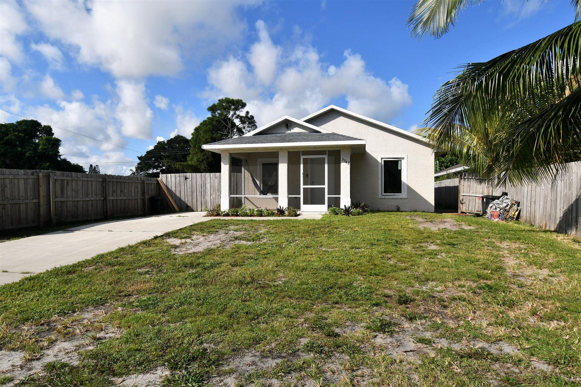 Photo of 5348 SE Driftwood Avenue, Stuart, FL 34997 (MLS # RX-10754029)