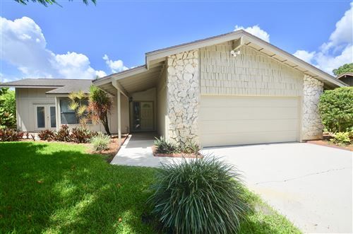Photo of 920 NE Town Terr Terrace, Jensen Beach, FL 34957 (MLS # RX-10636032)