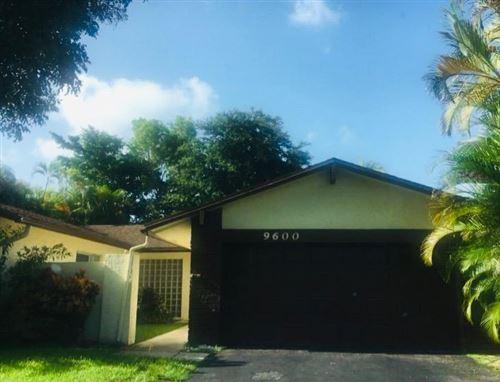 Photo of 9600 NW 32 Mnr Manor, Sunrise, FL 33351 (MLS # RX-10655033)