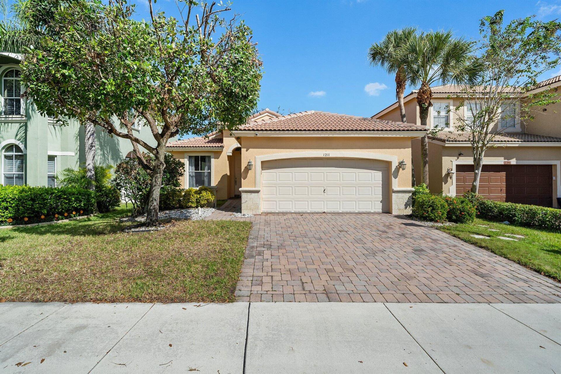 Photo of 1211 W Magnolia Circle, Delray Beach, FL 33445 (MLS # RX-10753034)