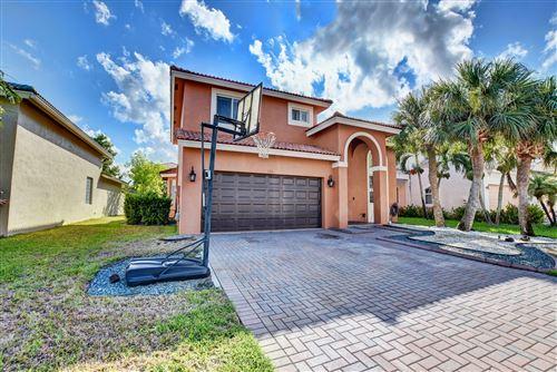 Foto de inmueble con direccion 120 Sarona Circle Royal Palm Beach FL 33411 con MLS RX-10664035