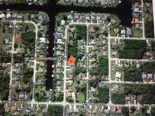 Photo of 18282 Wolbrette Circle, Port Charlotte, FL 33948 (MLS # RX-10555037)