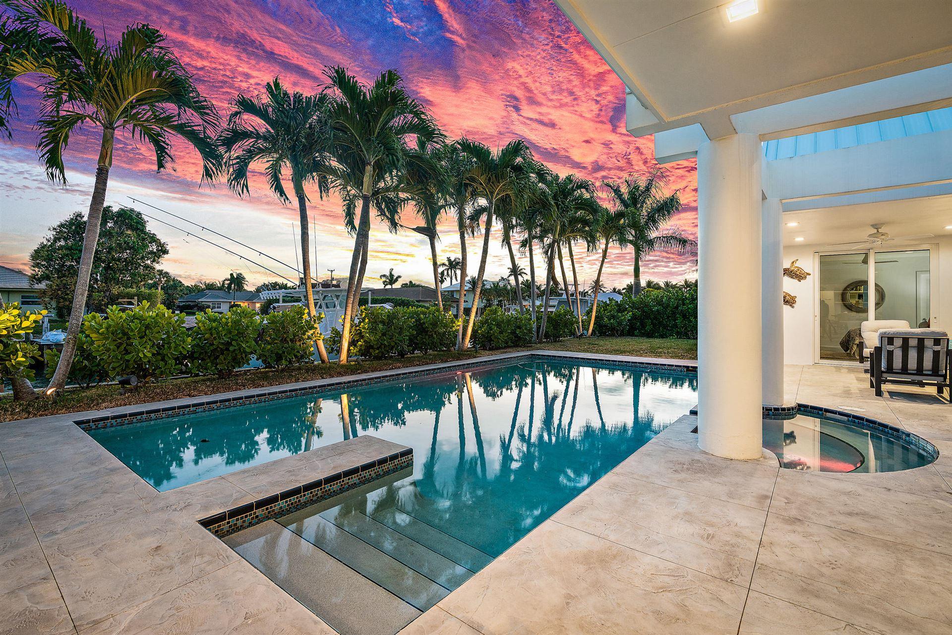 Photo of 1091 Grand Bahama Lane, Riviera Beach, FL 33404 (MLS # RX-10689037)