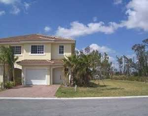 Photo of 1019 Imperial Lake Road, West Palm Beach, FL 33413 (MLS # RX-10624039)