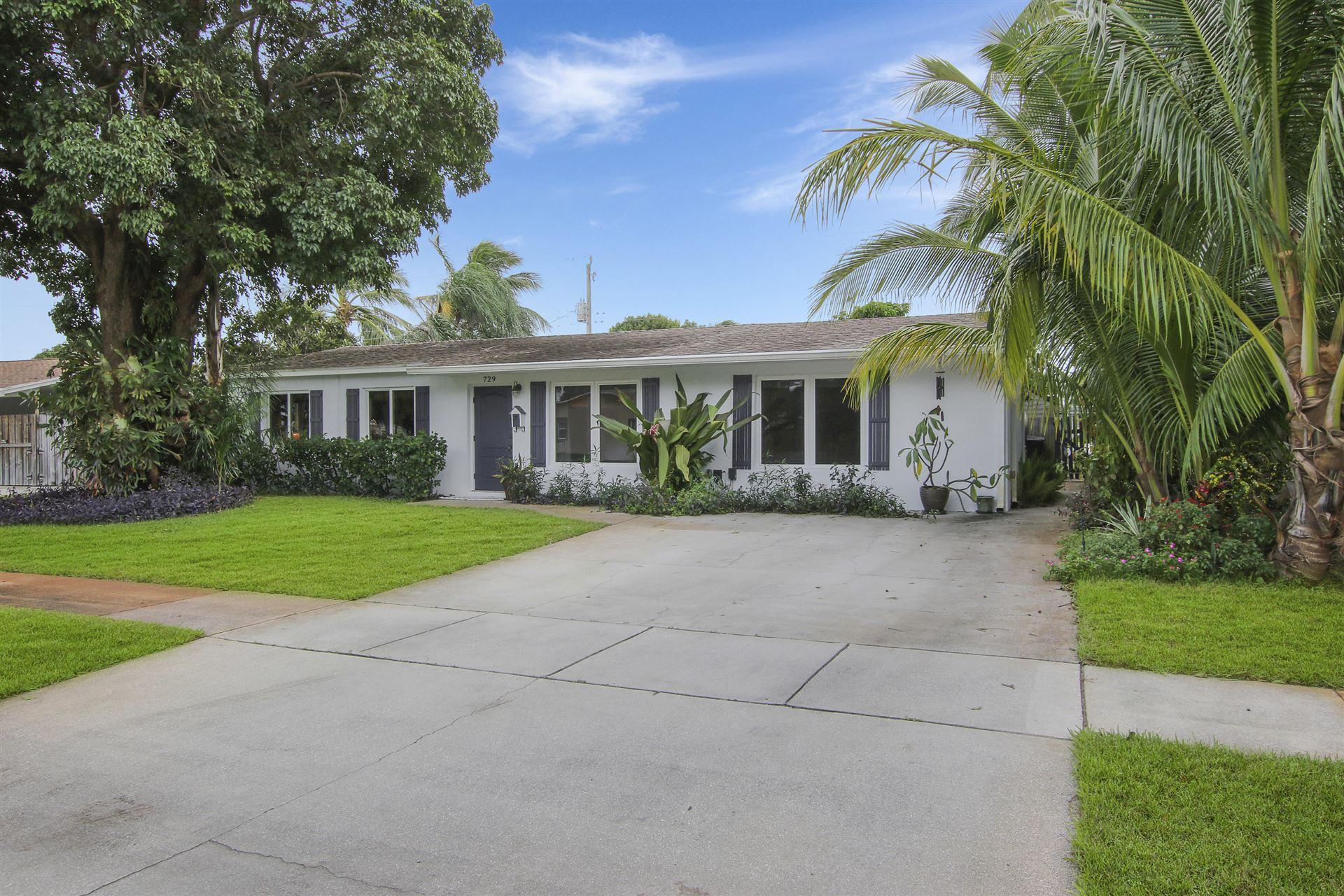 Photo of 729 Huckleberry Lane, North Palm Beach, FL 33408 (MLS # RX-10671039)