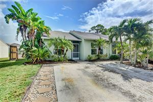 Photo of 128 Oakwood Drive, Jupiter, FL 33458 (MLS # RX-10563042)