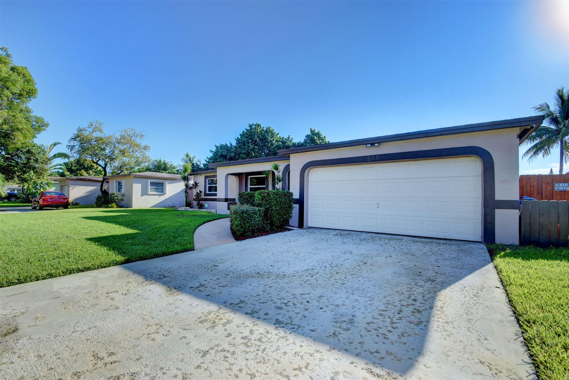 Photo of 558 NW 69th Terrace, Margate, FL 33063 (MLS # RX-10751042)