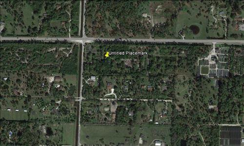 Photo of 14920 Okeechobee Boulevard, Loxahatchee Groves, FL 33470 (MLS # RX-10733046)