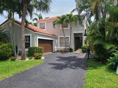 Photo of 6155 NW 77th Place, Parkland, FL 33067 (MLS # RX-10627048)