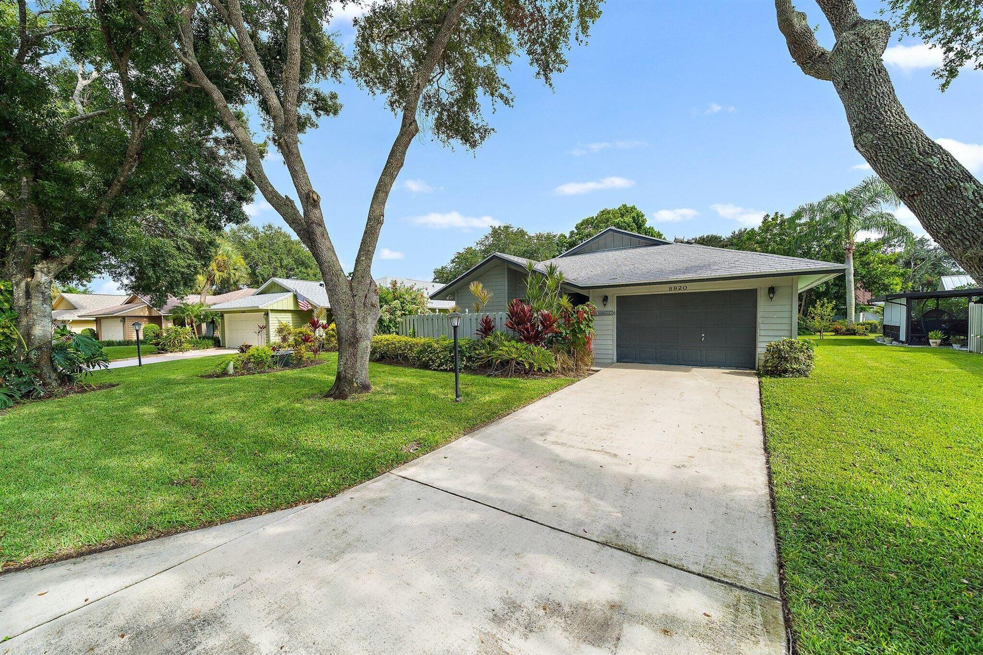 Photo of 8920 SE Eaglewood Way, Hobe Sound, FL 33455 (MLS # RX-10744048)