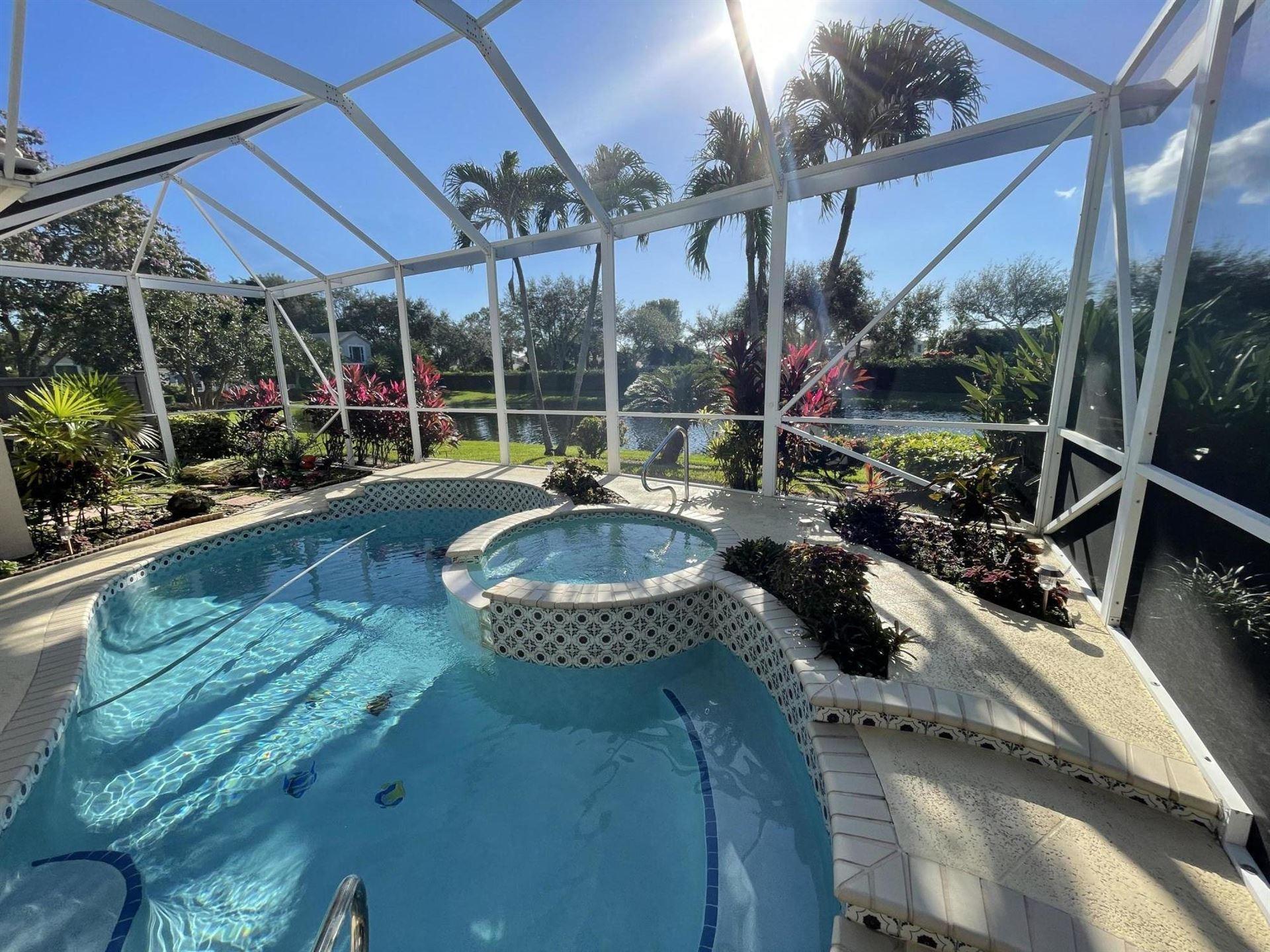 Photo of 937 Augusta Pointe Drive, Palm Beach Gardens, FL 33418 (MLS # RX-10685055)