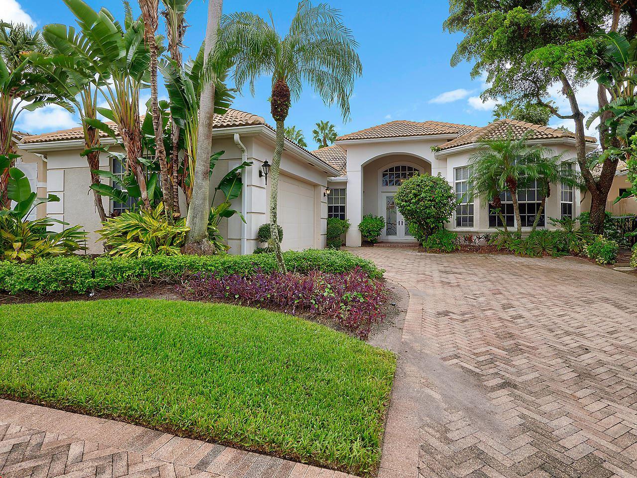 Photo of 133 Banyan Isle Drive, Palm Beach Gardens, FL 33418 (MLS # RX-10663058)