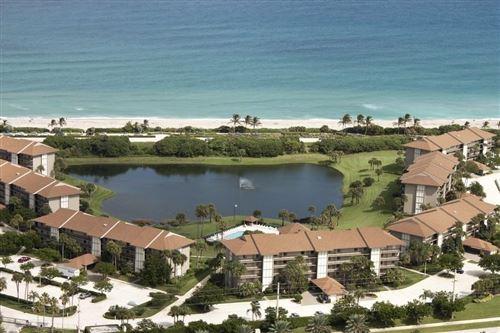 Photo of 301 S Seas Drive #302, Jupiter, FL 33477 (MLS # RX-10684063)