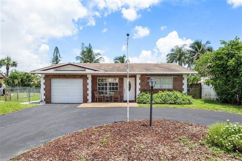 Photo of 3129 NW 65th Drive, Fort Lauderdale, FL 33309 (MLS # RX-10733065)
