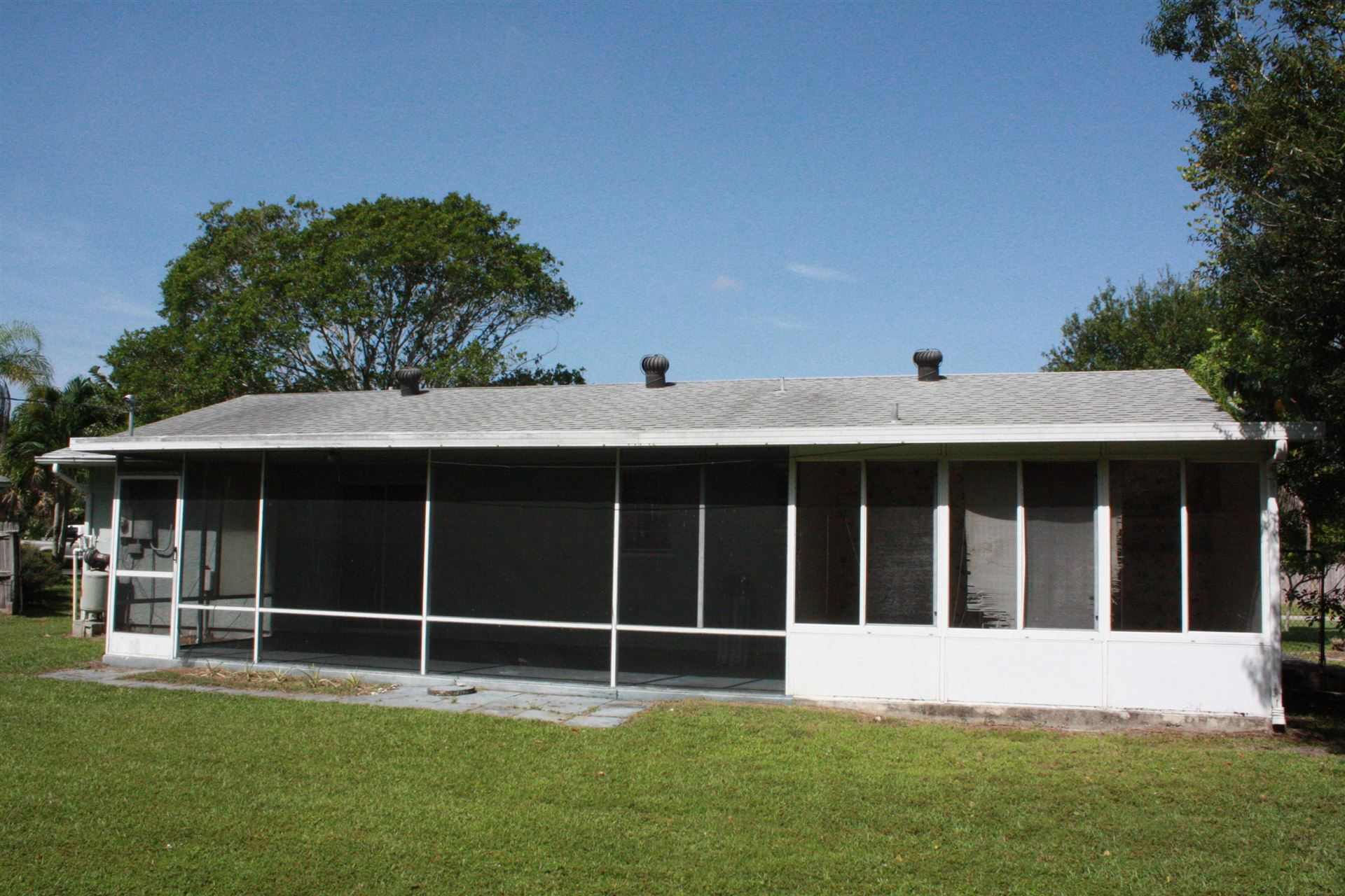 Photo of 2492 SE Betty Road, Port Saint Lucie, FL 34952 (MLS # RX-10636067)