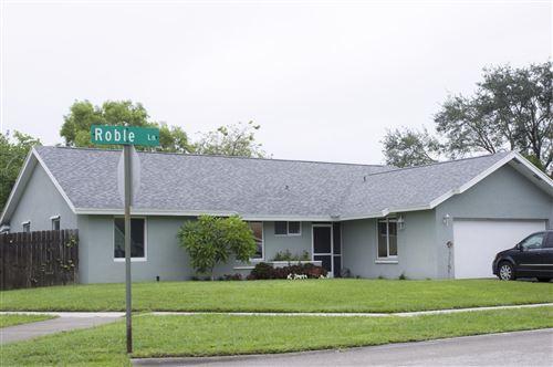Photo of 7827 Roble Lane, Lake Worth, FL 33467 (MLS # RX-10733068)