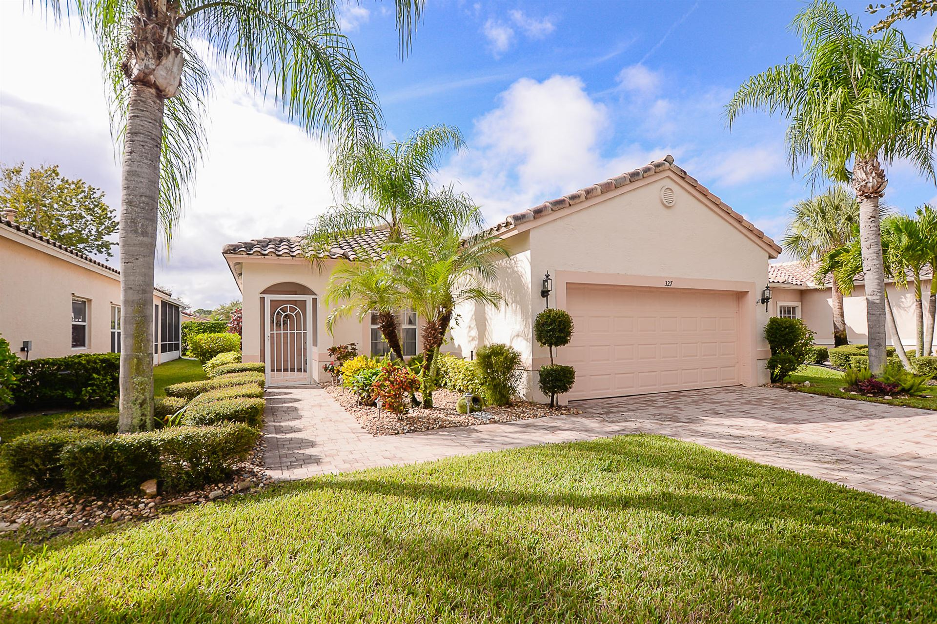 Photo of 327 NW Breezy Point Loop, Port Saint Lucie, FL 34986 (MLS # RX-10660071)