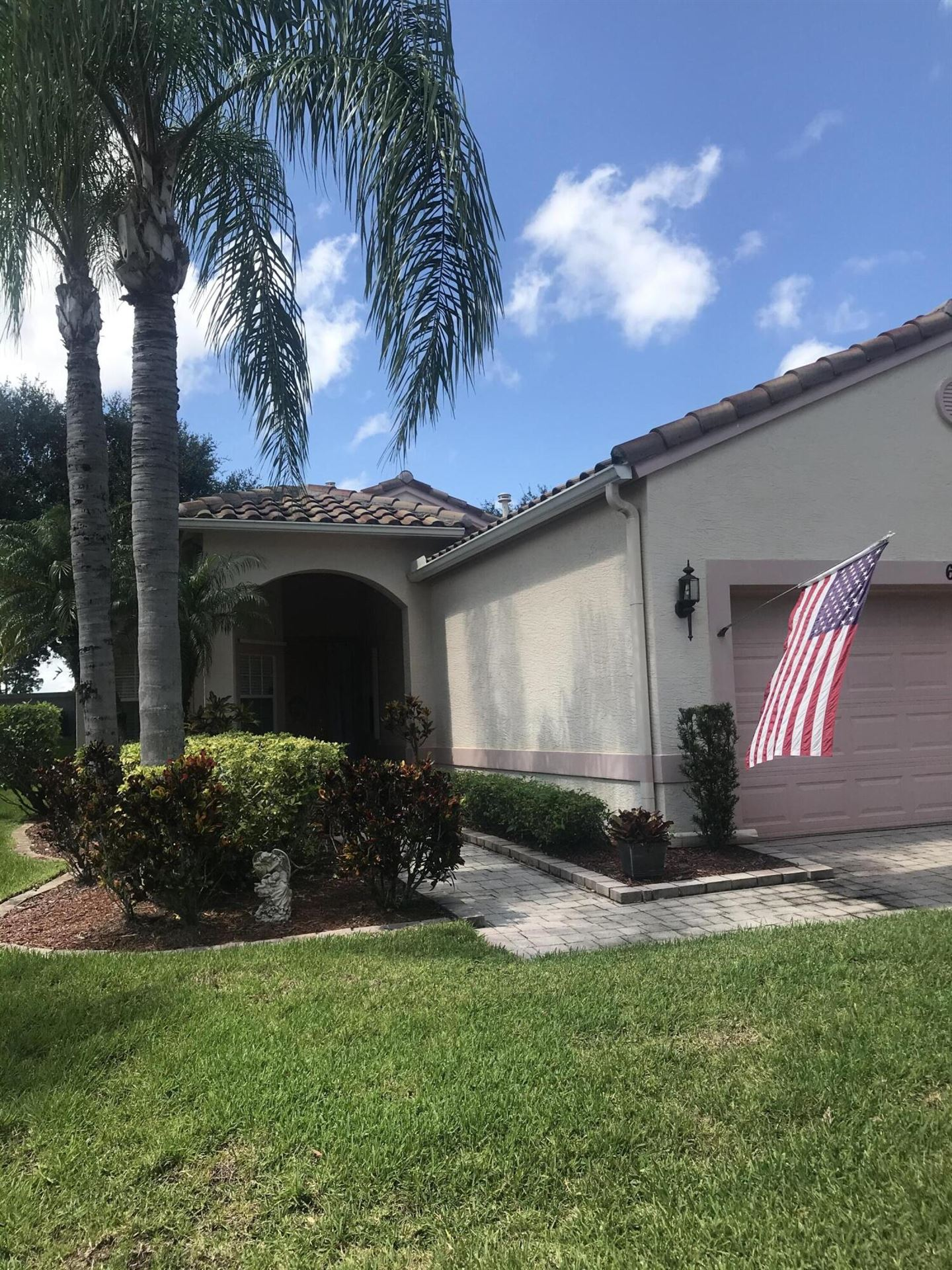 Photo of 629 NW Whitfield Way, Port Saint Lucie, FL 34986 (MLS # RX-10749071)