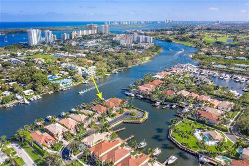 Photo of 702 Sandy Point Lane, North Palm Beach, FL 33410 (MLS # RX-10696072)