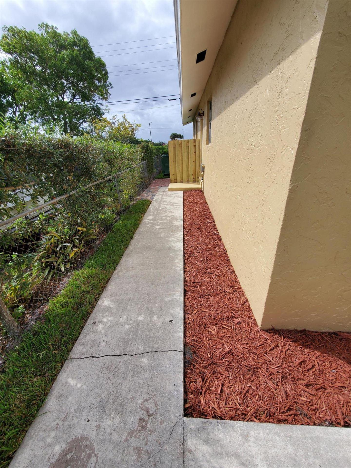 Photo of 1273 W 23rd Street, Riviera Beach, FL 33404 (MLS # RX-10655073)