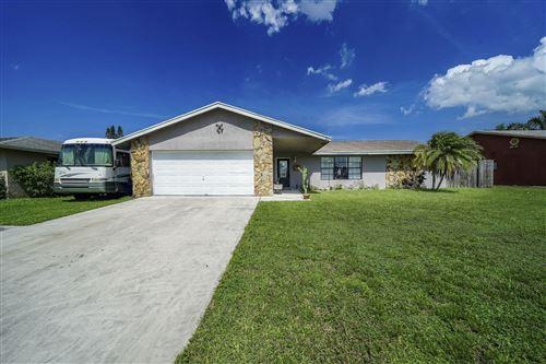 Photo of 307 Las Palmas Street, Royal Palm Beach, FL 33411 (MLS # RX-10639077)