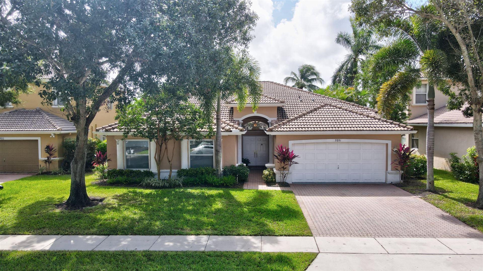 Photo of 5951 Bay Hill Circle, Lake Worth, FL 33463 (MLS # RX-10667077)