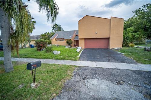 Photo of 6940 NW 45 St, Lauderhill, FL 33319 (MLS # RX-10724078)