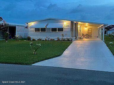 Photo of 7878 SE Continental Drive, Hobe Sound, FL 33455 (MLS # RX-10752080)
