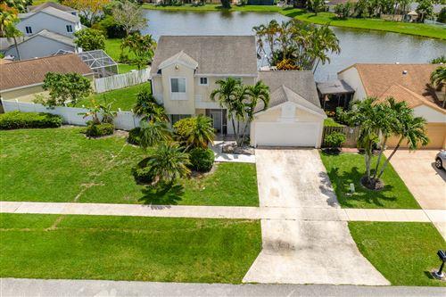 Photo of 9868 Robins Nest Road, Boca Raton, FL 33496 (MLS # RX-10633086)