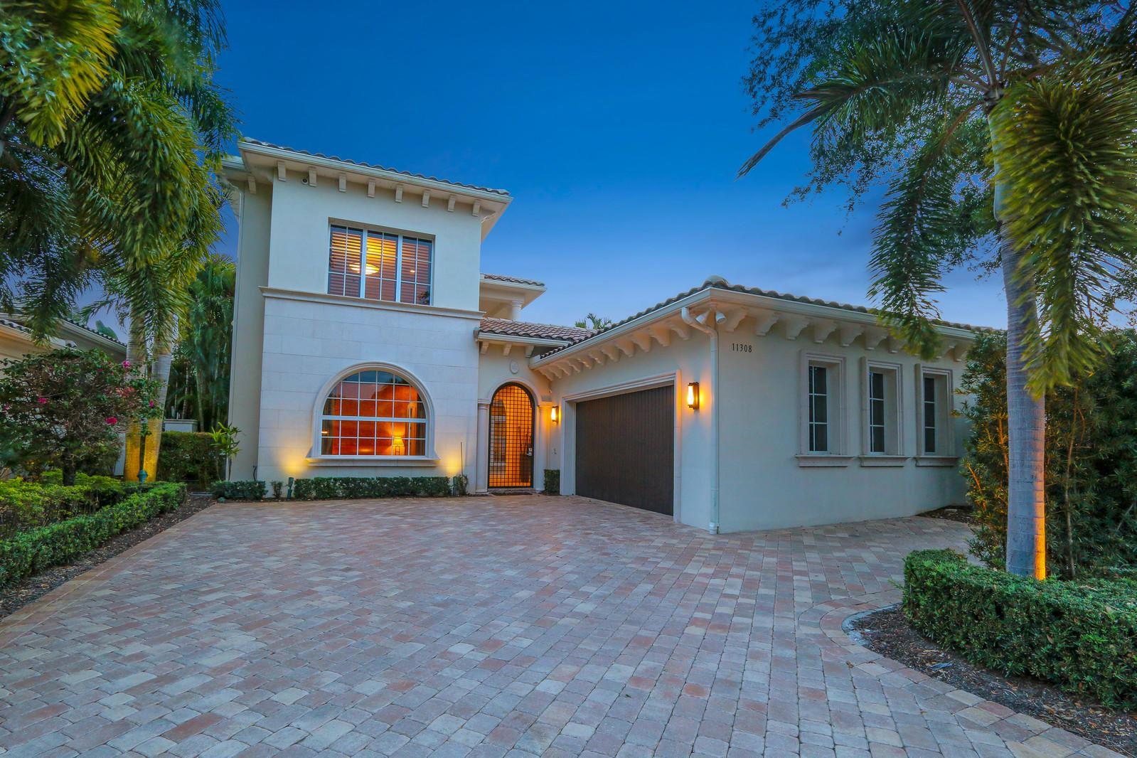 Photo of 11308 Caladium Lane, Palm Beach Gardens, FL 33418 (MLS # RX-10608089)